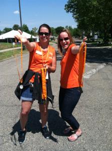 Elana and Sarah offer medals at Bike MS 2014